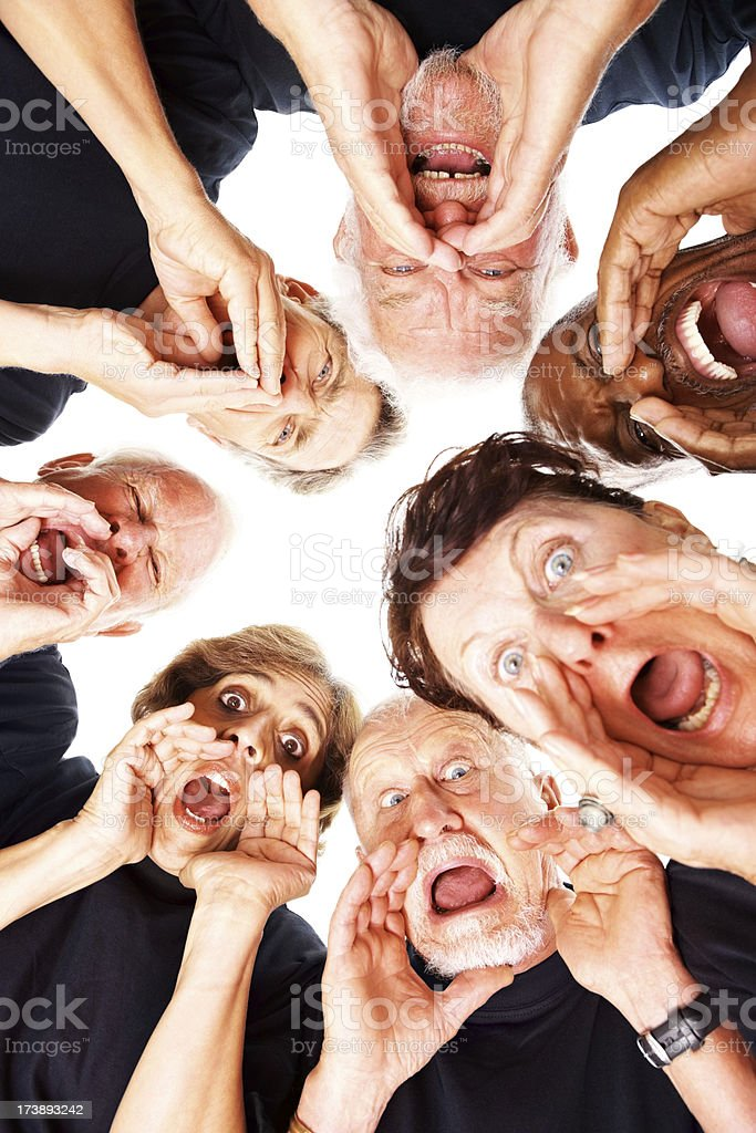 Crazy senior people screaming loudly over white royalty-free stock photo