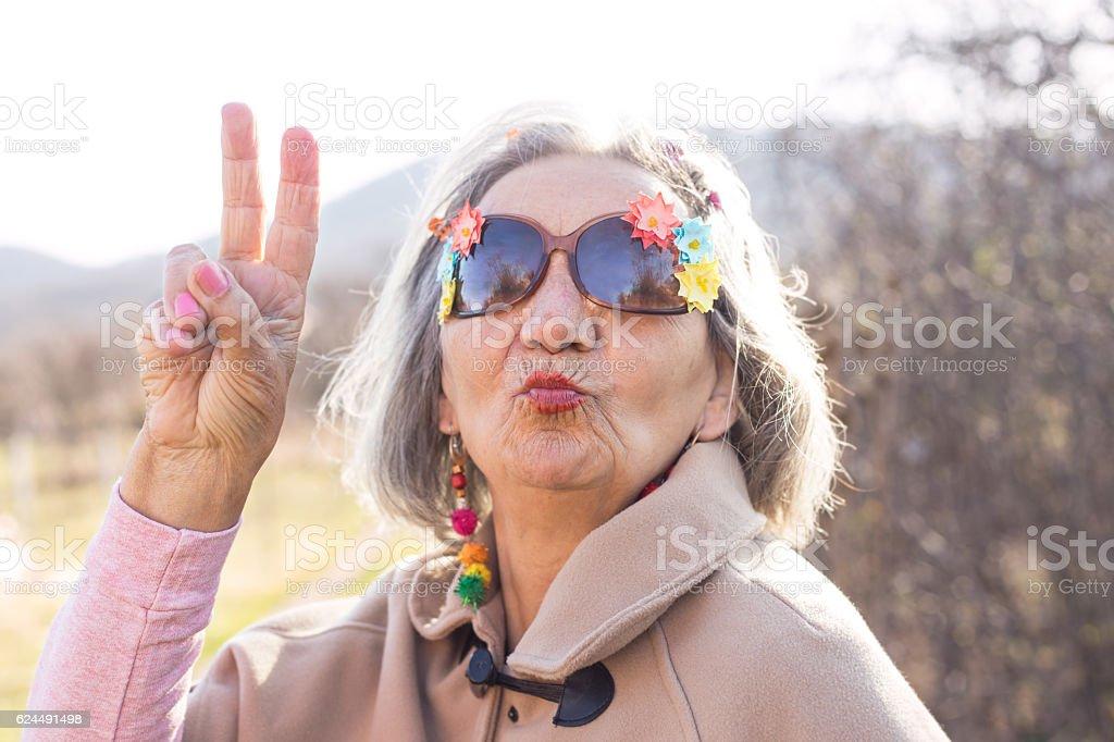crazy senior woman kissing stock photo