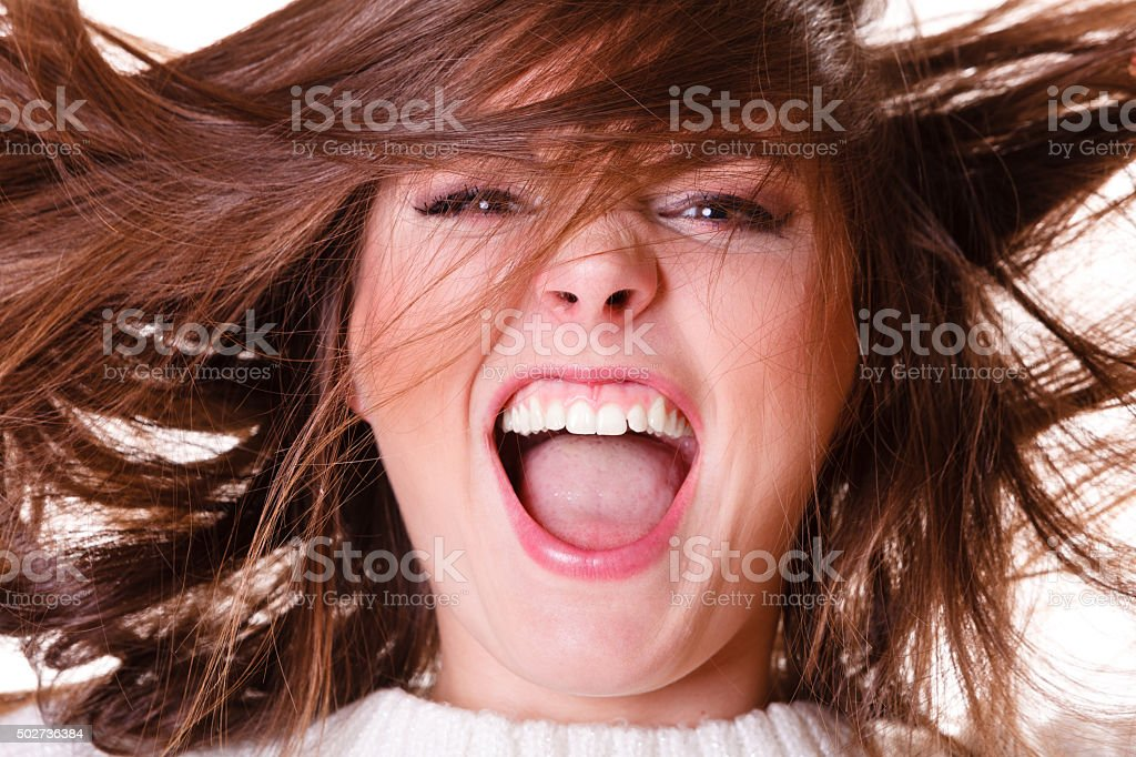 Crazy shouting happy girl. stock photo
