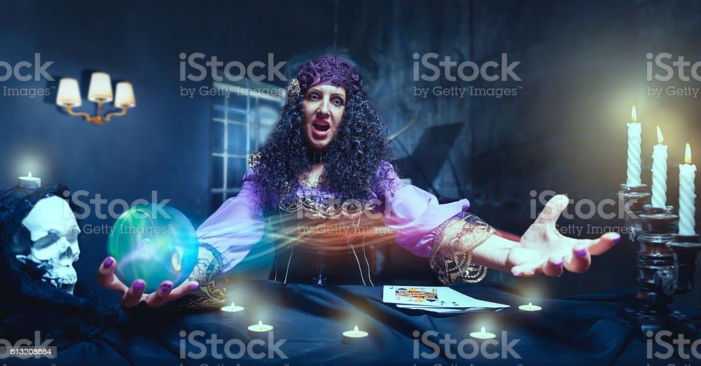 Crazy sorceress practising witchcraft stock photo