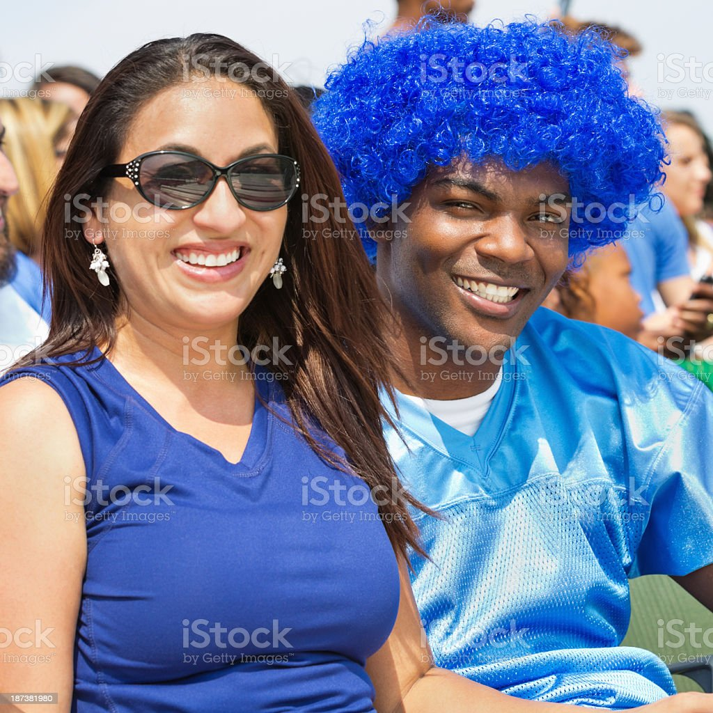 Crazy sports fans cheering for team in stadium bleachers royalty-free stock photo