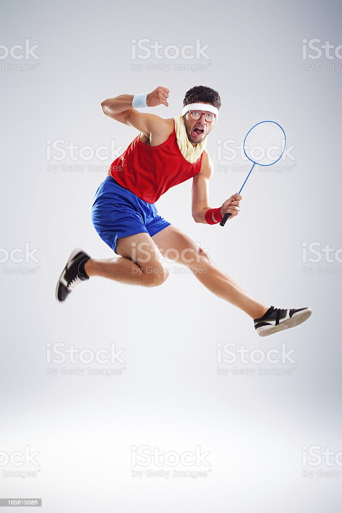 Crazy tennis player with glasses jumping up in air stock photo