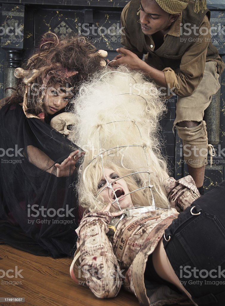Crazy Voodoo Family With Hostage royalty-free stock photo