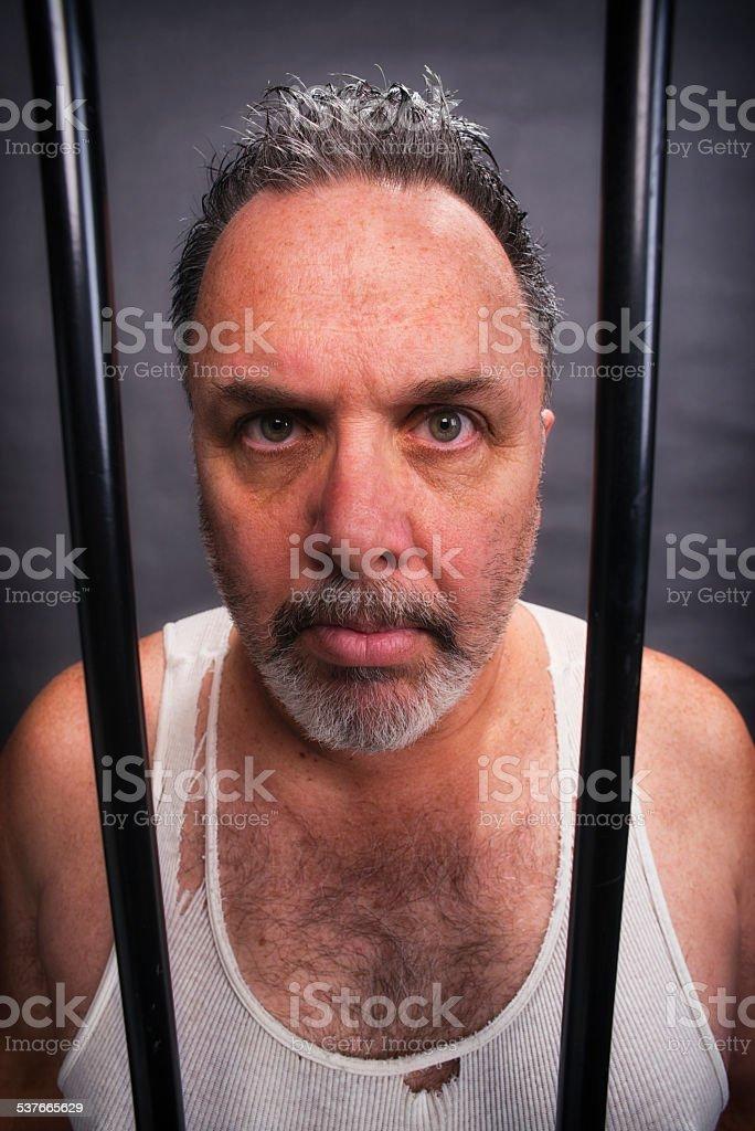 Crazy white man in jail stock photo