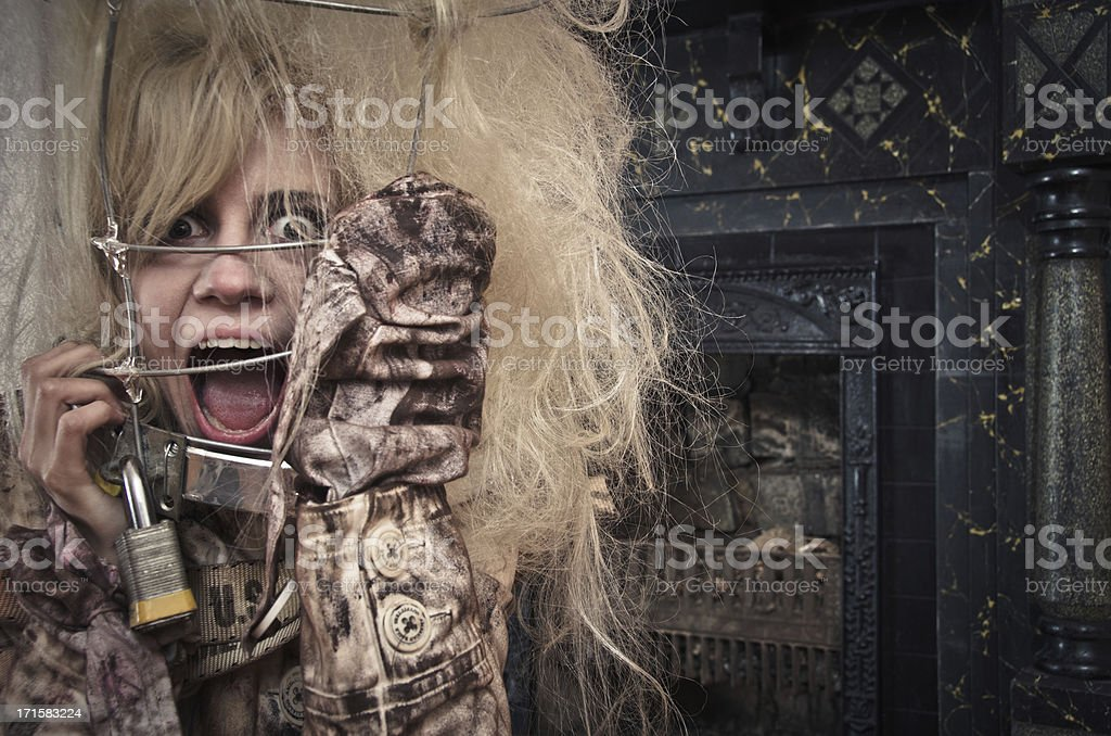 Crazy Woman in a Straightjacket and Cage royalty-free stock photo