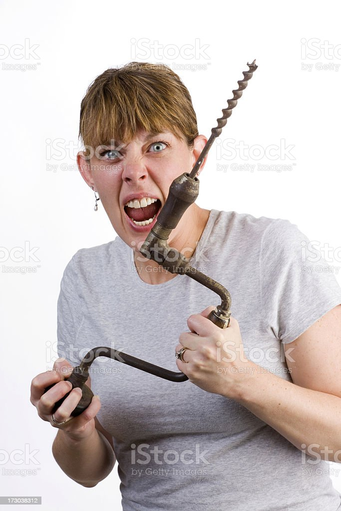 Crazy woman with old hand drill royalty-free stock photo