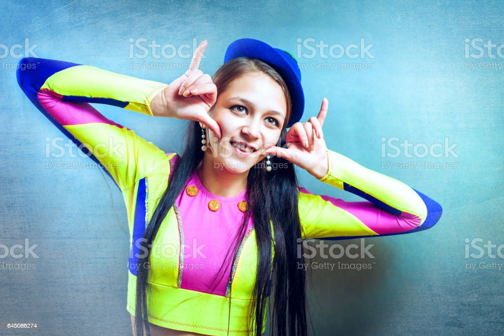 Crazy young girl in a suit  clown stock photo