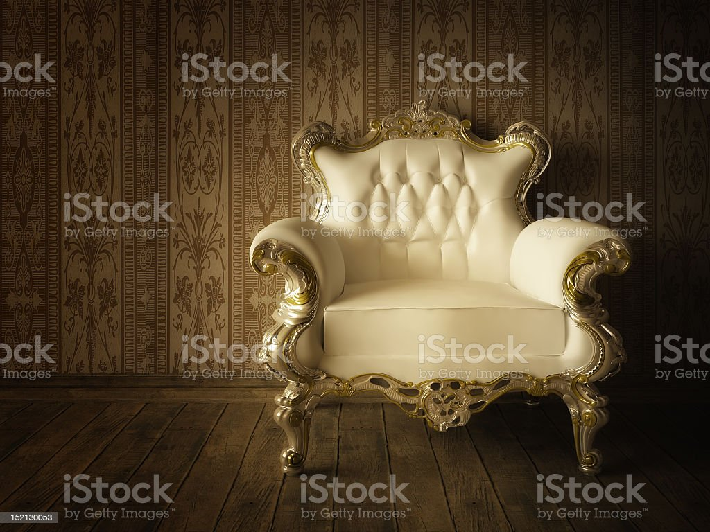 Cream and gold antique armchair stock photo