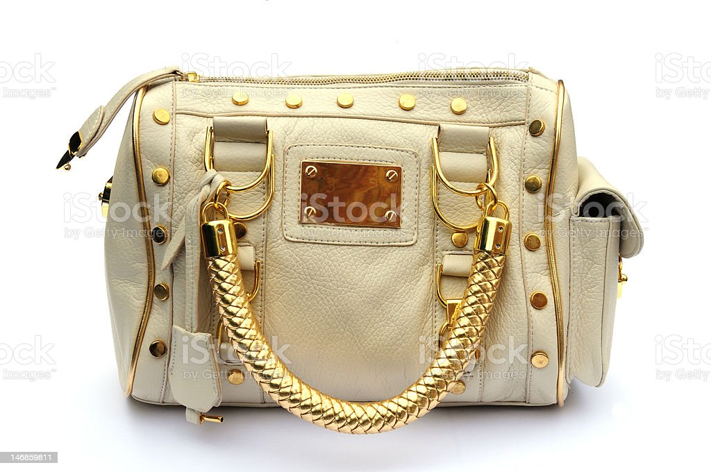 cream and gold bag royalty-free stock photo