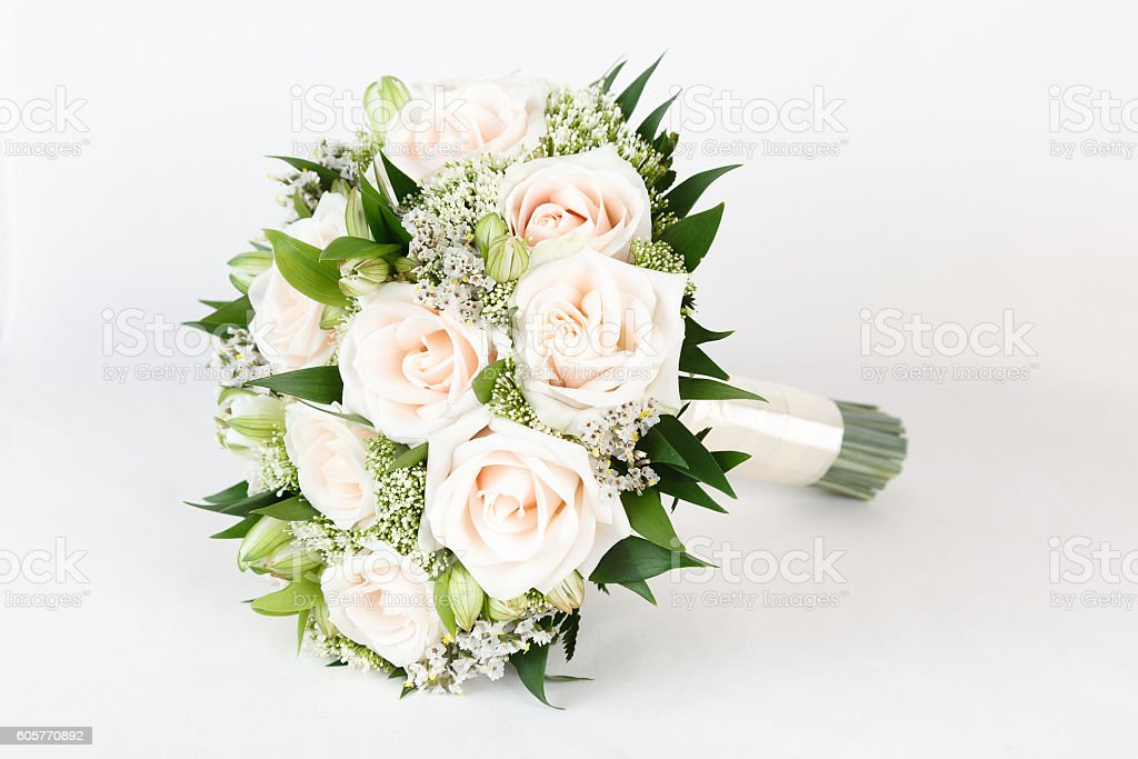 Cream and green wedding bouquet of roses and alstroemeria flowers stock photo