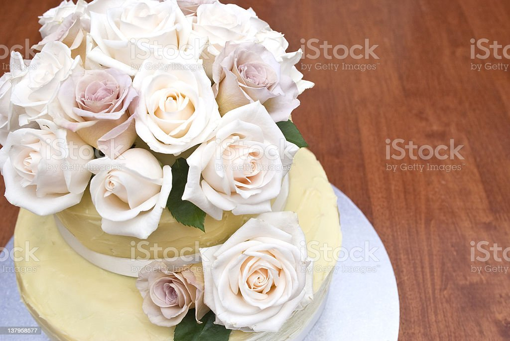 Cream and latte roses on a beautiful cake stock photo