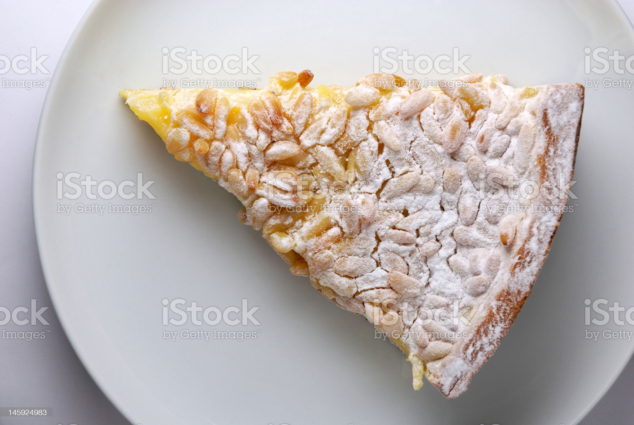 Cream and pine seed cake royalty-free stock photo
