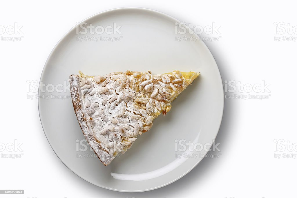 Cream and pine seed cake with clipping path royalty-free stock photo