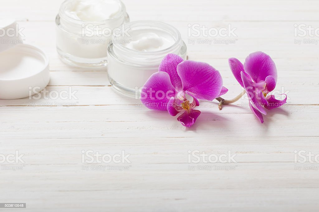 cream and pink orchid flowers on white wooden background stock photo
