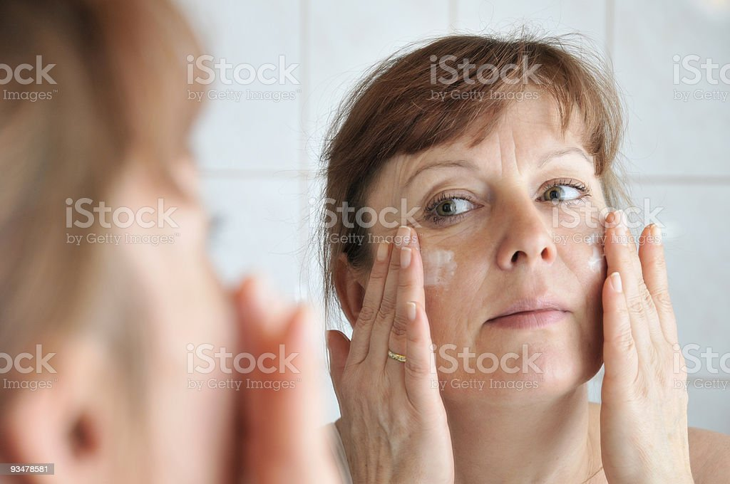 cream at the face royalty-free stock photo