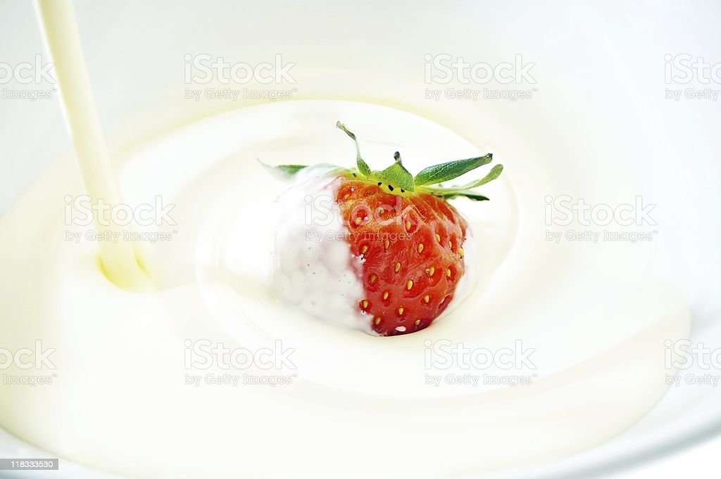 cream being pored over strawberry royalty-free stock photo
