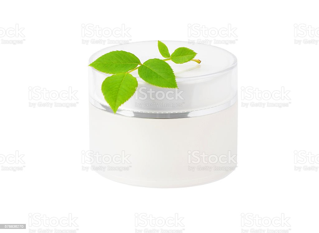 Cream can and green leaf stock photo
