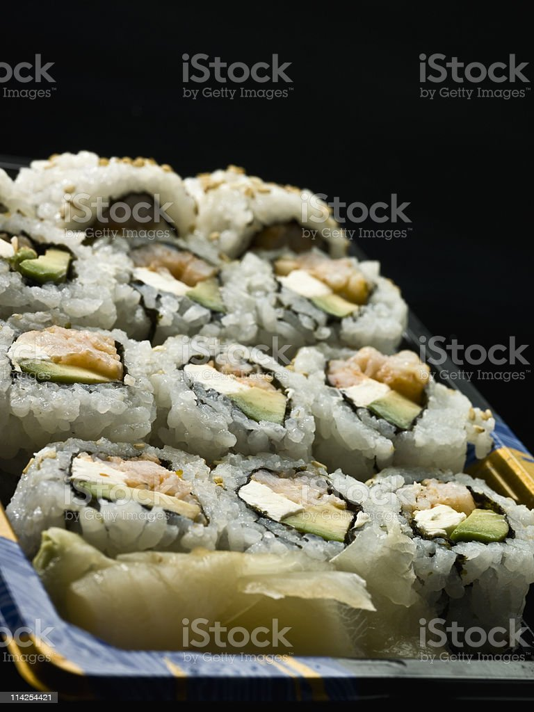 Cream cheese, avocado, and seafood sushi royalty-free stock photo