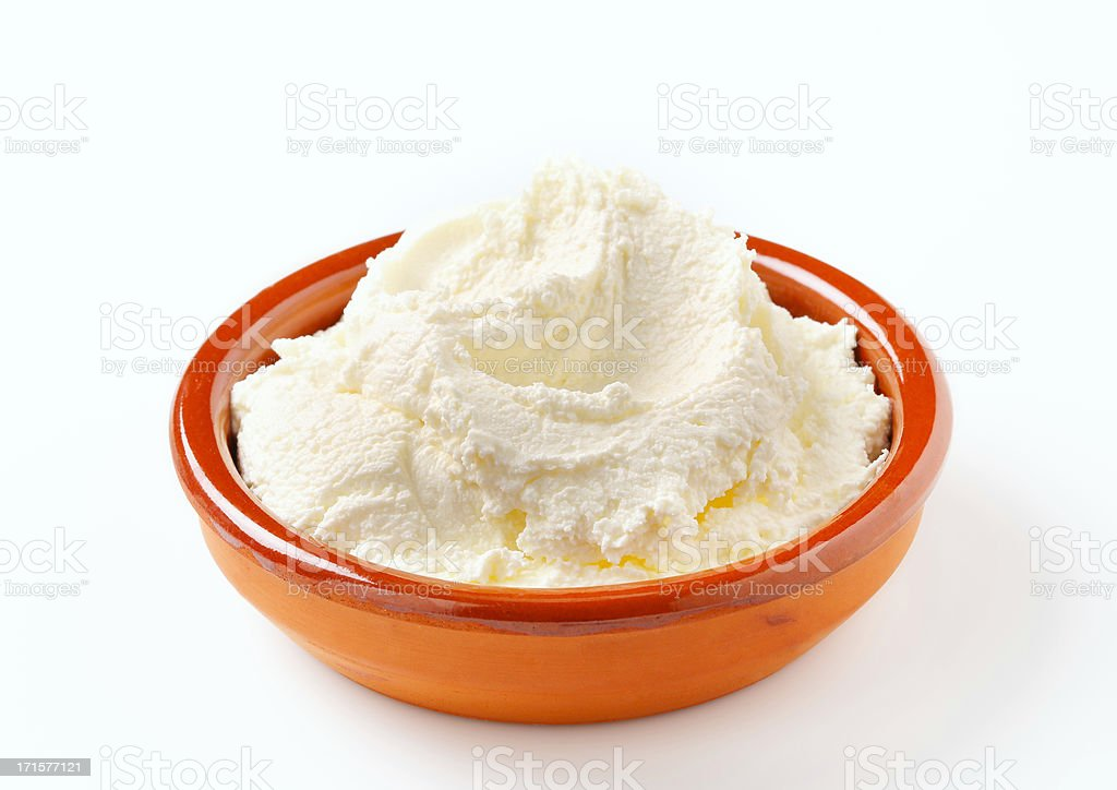 cream cheese in a bowl stock photo