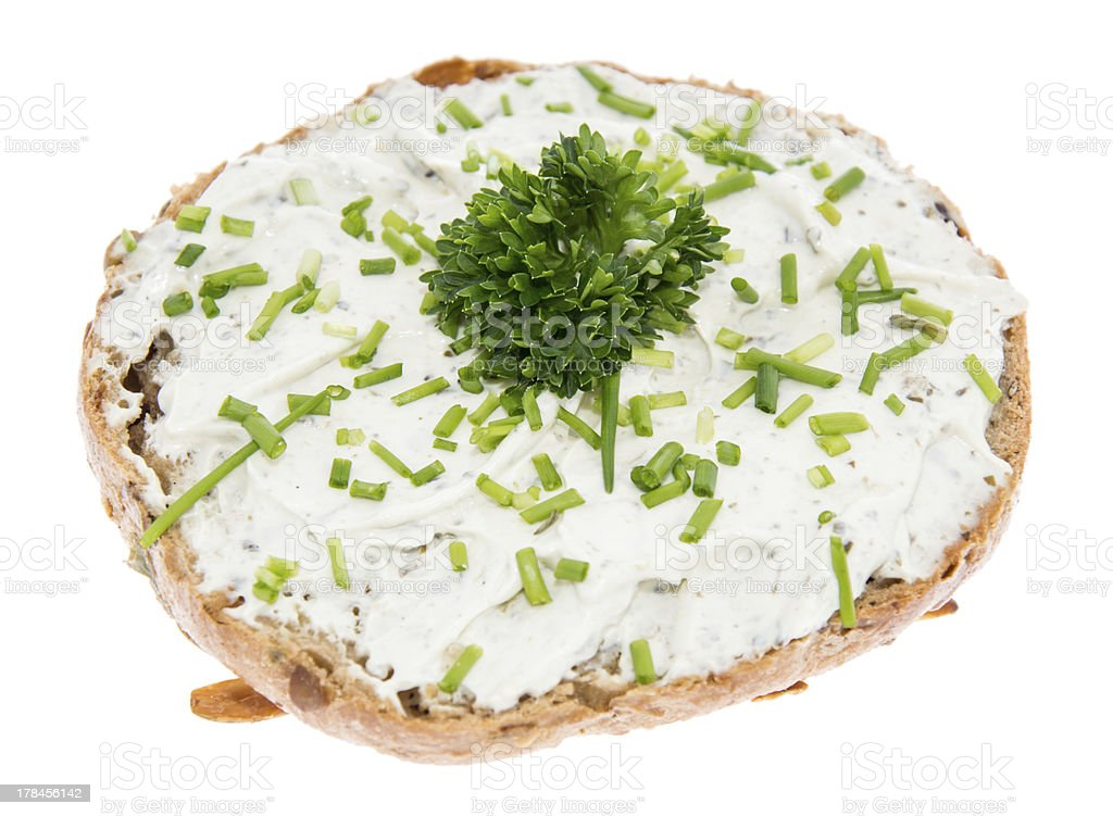Cream Cheese on a roll with herbs stock photo