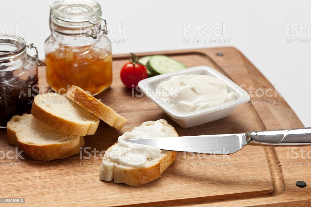 cream cheese putting on bread royalty-free stock photo