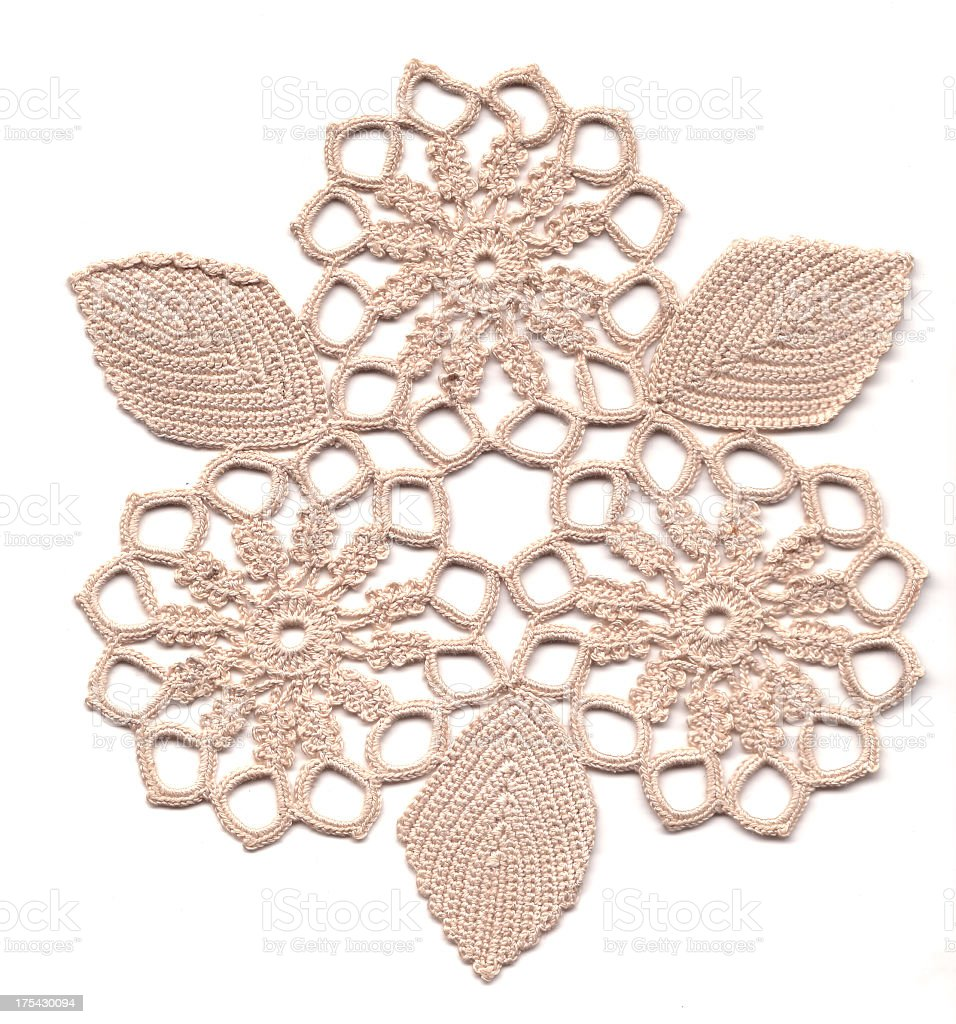 Cream color crocheted flower lace stock photo