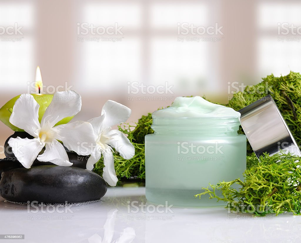 Cream jar algae front view with windows background stock photo