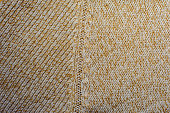 Cream knitted woolen fabric texture