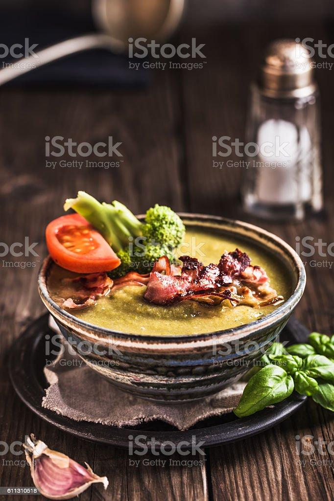 Cream of broccoli soup rustic style stock photo