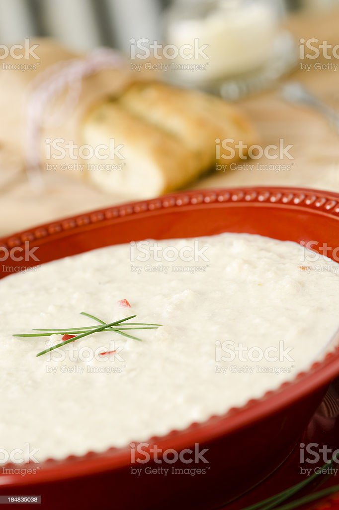 Cream of Cauliflower Soup in a Red Bowl stock photo