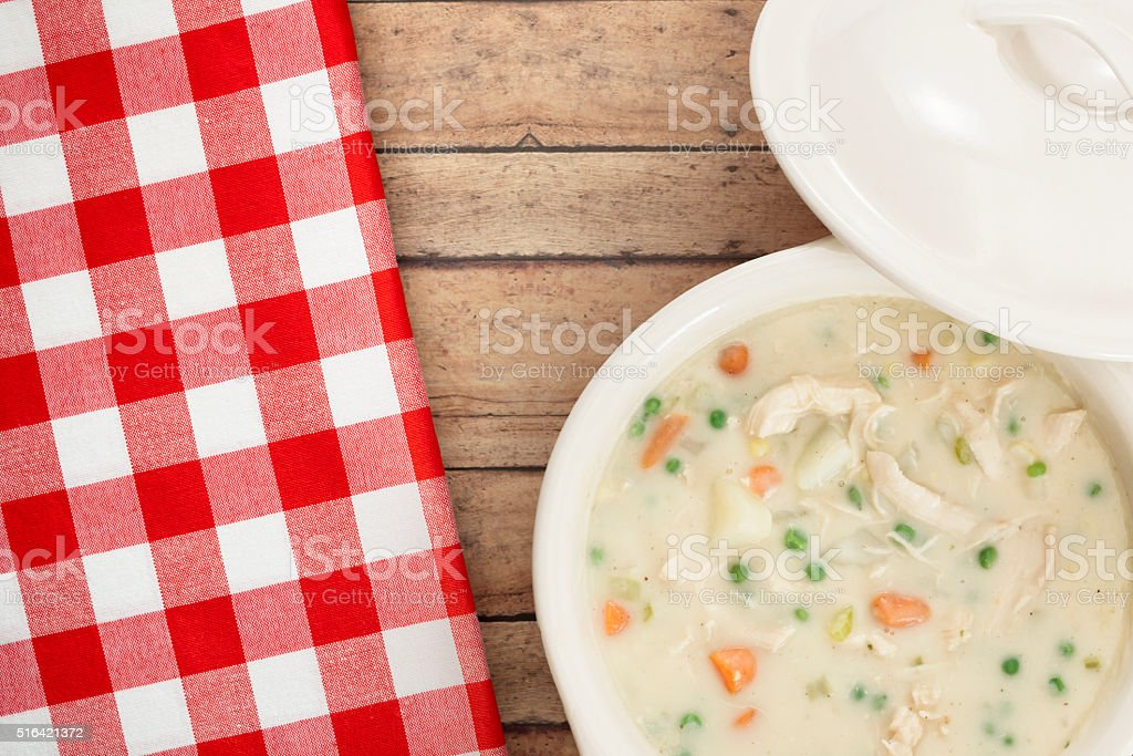 Cream of Chicken Soup on Country Style Background stock photo