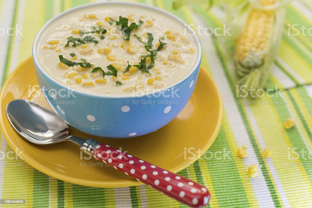 Cream of corn soup in blue bowl royalty-free stock photo
