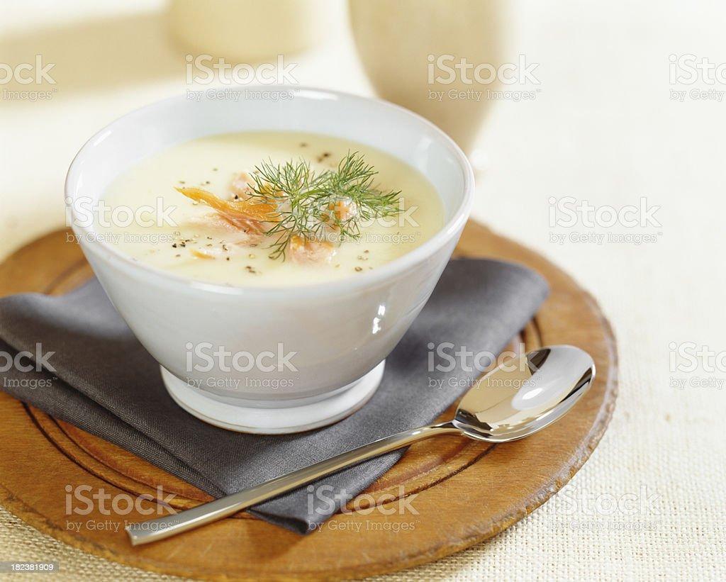Cream of potato soup with salmon stock photo