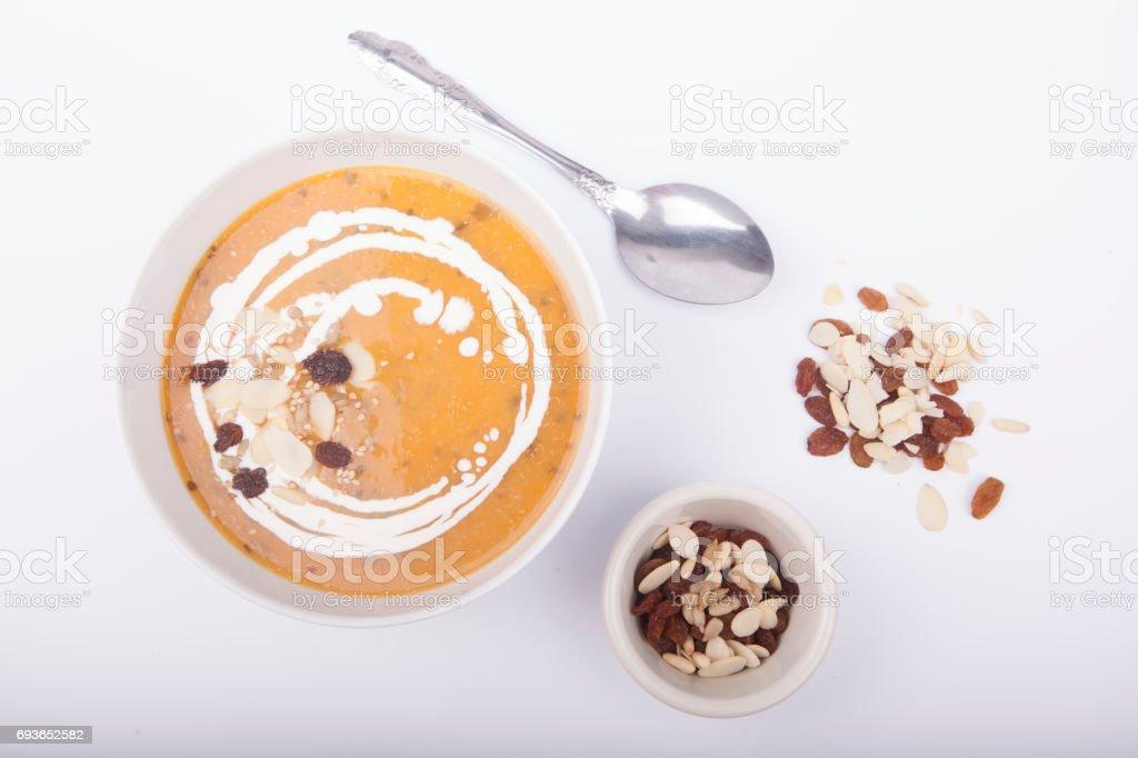 cream of pumpkin carrot and potato soup stock photo