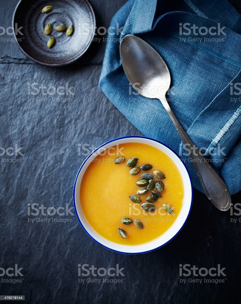 Cream of pumpkin soup with pumpkin seeds stock photo