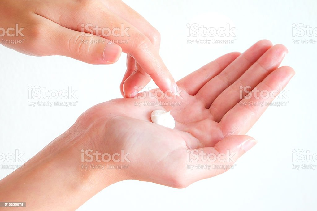 cream on woman hand with isolated background2 stock photo