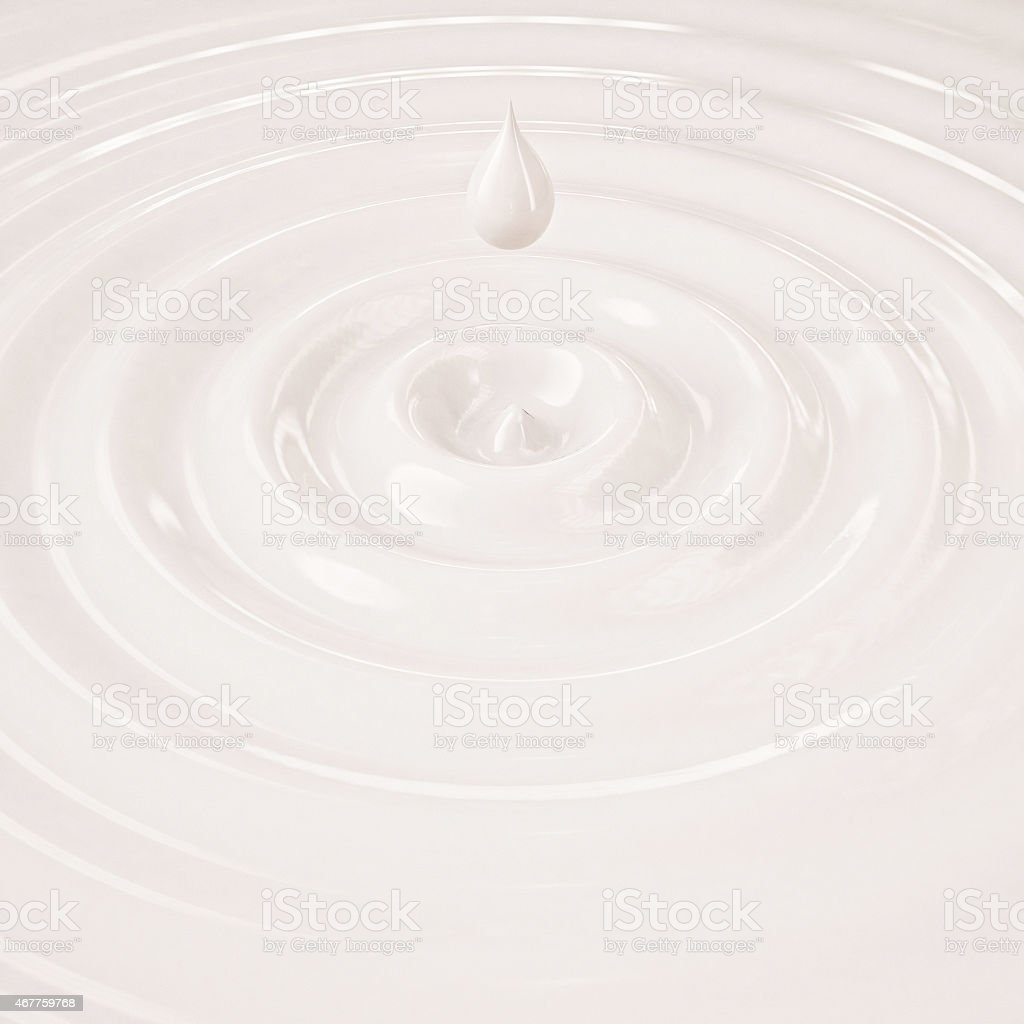 cream or milk liquid drop with waves stock photo