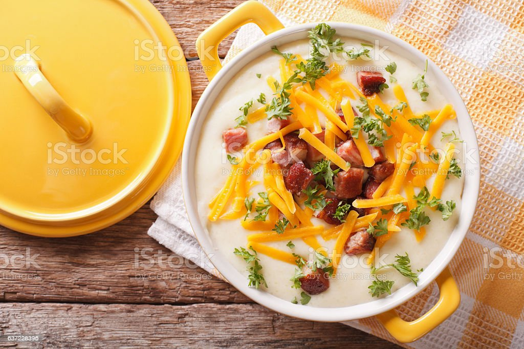 cream potato soup with bacon and cheddar cheese close-up. horizontal stock photo