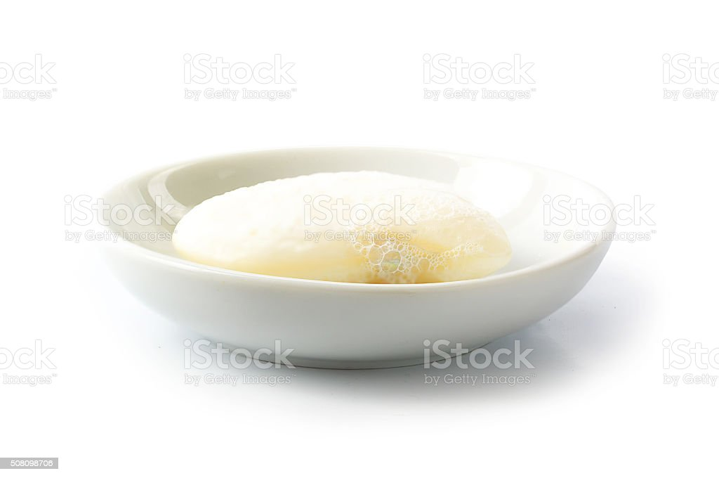 Cream Soap with foam in a  bowl isolated on white stock photo