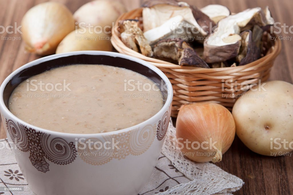 Cream- soup of dried porcini mushrooms with potato and onion stock photo