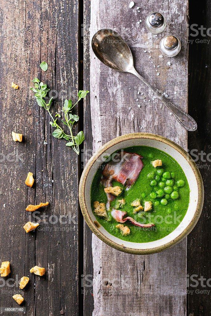 Cream soup of green peas stock photo