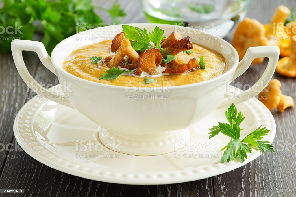 Cream soup with chanterelle mushrooms and pumpkin. stock photo