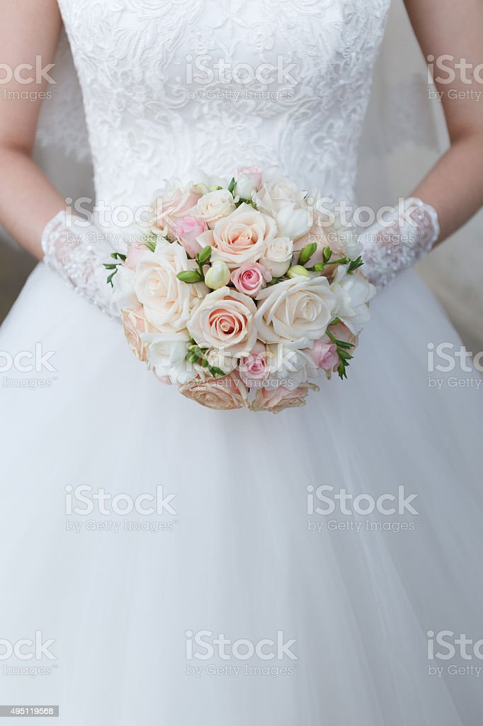Cream wedding bouquet of roses and freesias stock photo