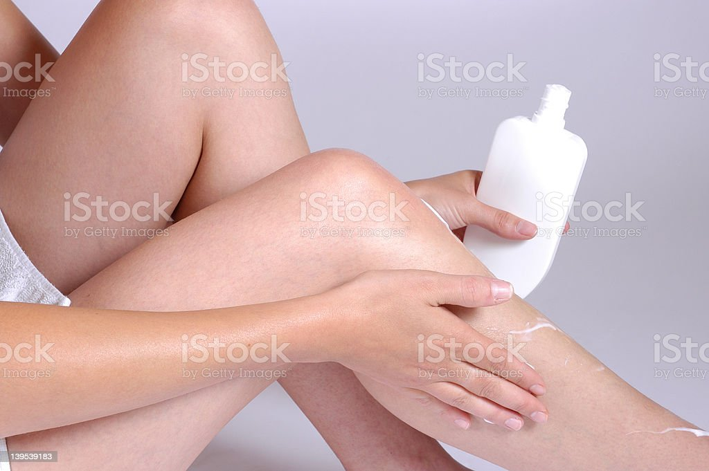 creaming the legs royalty-free stock photo