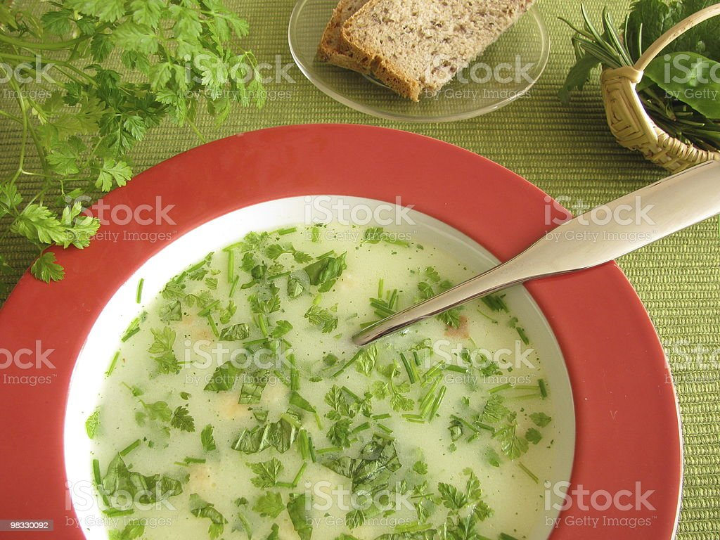 Cream-soup with herbs stock photo