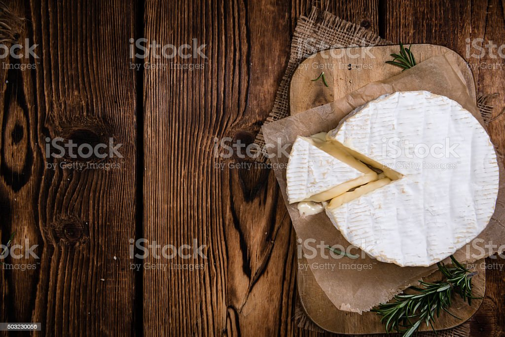 Creamy Camembert on wooden background stock photo