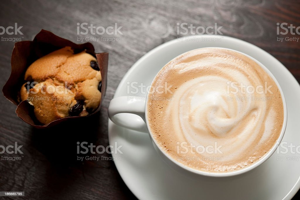 Creamy Cappuccino with Blueberry muffin royalty-free stock photo