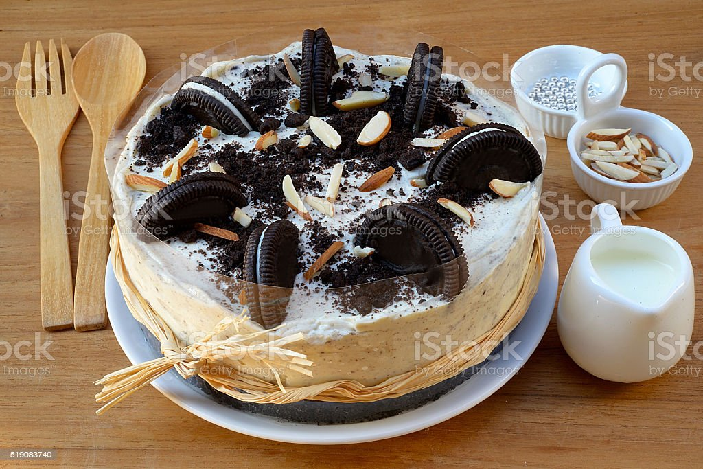 Creamy cheesecake with chocolate cookies and cream biscuits. stock photo