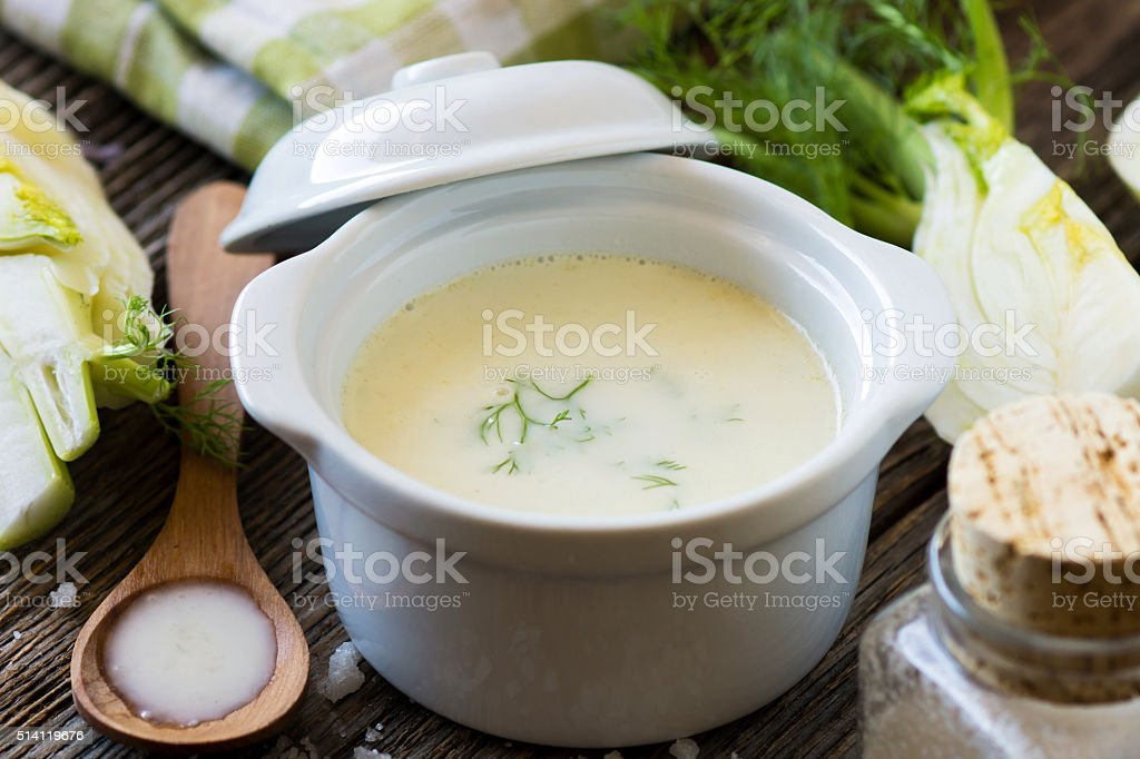 Creamy fennel soup with fresh herbs stock photo
