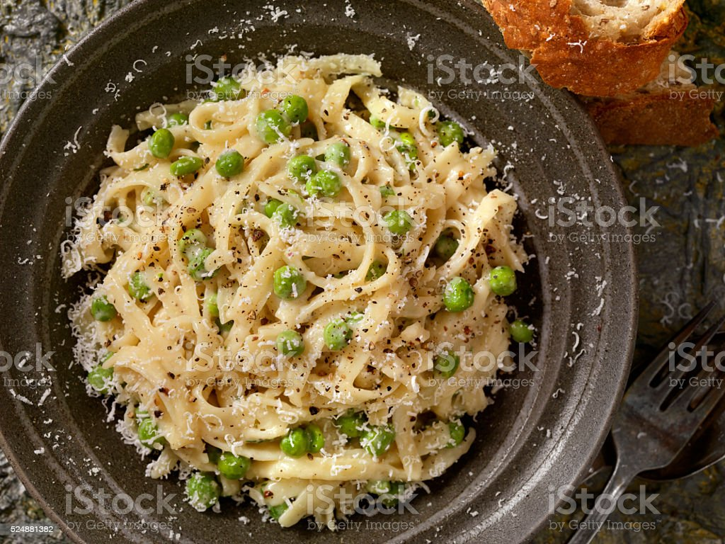 Creamy Fettucini with Peas and Parmesan stock photo